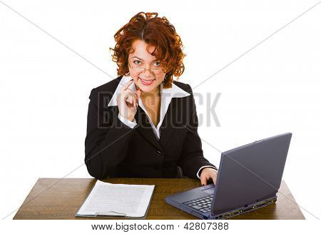 young smiley attractive businesswoman sitting at table with laptop