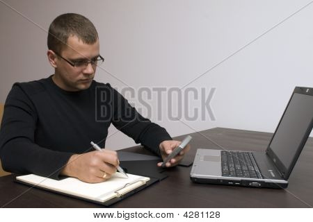 Man Writing And Texting