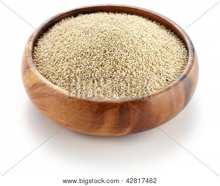 uncooked quinoa in the wooden bowl