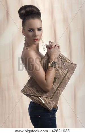 Fashion Brunette In Jeans With Big Bag And Body In Profile
