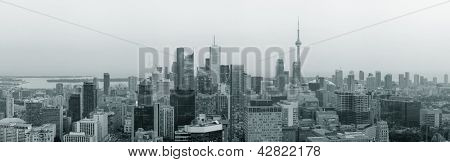 Toronto at dusk with city light and urban skyline with skyscrapers in black and white