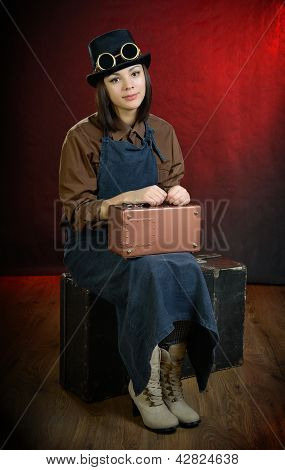 Steam Punk Girl Porter Sitting On Suitcase
