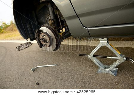 Changing a broken wheel on a car