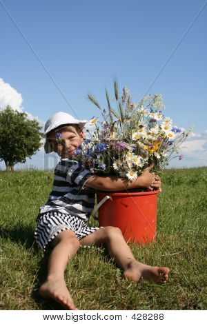 Child And Flowers
