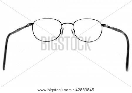 Black eyeglasses on white looking through lenses