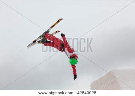 BUKOVEL, UKRAINE - FEBRUARY 23: Chao Wu, China performs aerial skiing during Freestyle Ski World Cup in Bukovel, Ukraine on February 23, 2013.