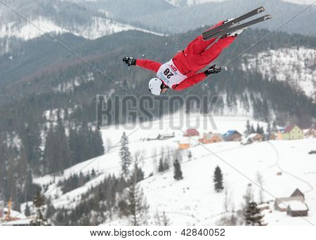 BUKOVEL, UKRAINE - FEBRUARY 23: Mischa Gasser, Switzerland performs aerial skiing during Freestyle Ski World Cup in Bukovel, Ukraine on February 23, 2013.