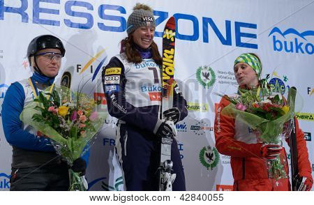 BUKOVEL, UKRAINE - FEBRUARY 23: Emily Cook, USA (center), Nadiya Didenko, Ukraine (left) and Tanja Schaerer, Switzerland win medals on Freestyle Ski World Cup in Bukovel, Ukraine on February 23, 2013