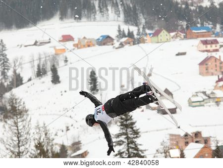 BUKOVEL, UKRAINE - FEBRUARY 23: Baglan Inkarbek, Kazakhstan performs aerial skiing during Freestyle Ski World Cup in Bukovel, Ukraine on February 23, 2013.