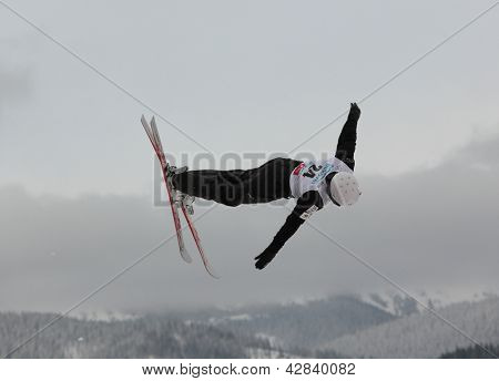 BUKOVEL, UKRAINE - FEBRUARY 23: Naoya Tabara, Japan performs aerial skiing during Freestyle Ski World Cup in Bukovel, Ukraine on February 23, 2013.