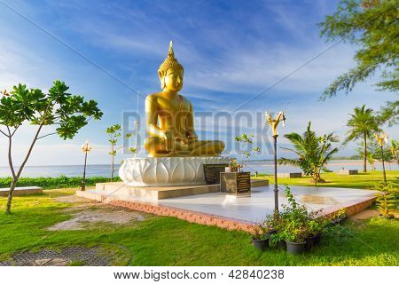 PHANG NGA, THAILAND - NOV 15: Statue of golden Buddha Buddha that sits back to the sea and directly to the Ban Nam Khem Tsunami Memorial Park. Pilgrimage site in Phang Nga, Thailand, Nov.15, 2012