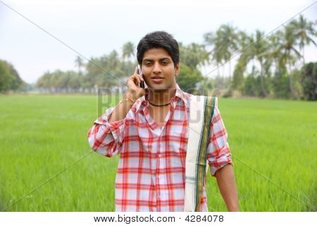 Asian Farmer Talking In His Cell Phone