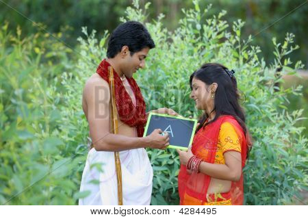 Asian Rural Couple Learning To Read And Write