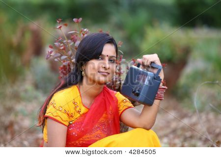 Asian Rural Woman Listening To Radio