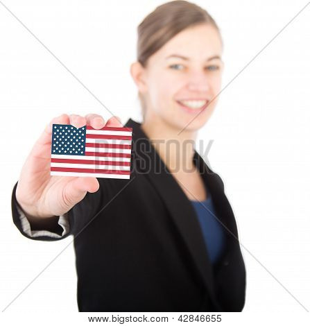 Business Woman Holding A Card With The Usa Flag