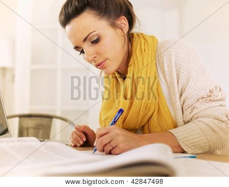 Studious Woman Writing Something