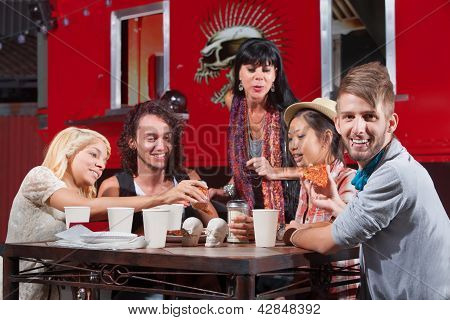 Smiling Hipster With Friends Eating