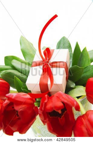 Image of fresh tulip bouquet in the pot, little gift box for mom, festive still life, isolated on white background, happy mothers day, valentine day, present for birthday, love and romance concept