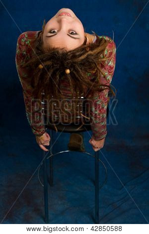 Portrait Of A Beautiful  Woman With Dreadlocks Against  A Blue Background