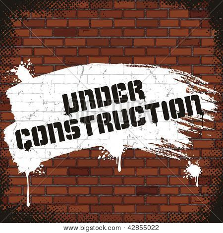 Under Construction Sign, Painted on Old Brick Wall. Vector Image
