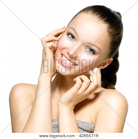 Beauty Model Girl Portrait . Beautiful Woman Face. Looking at Camera. Isolated on White Background. Pretty Girl Touching her Face. Smiling, Laughing, Happy Teenage Girl