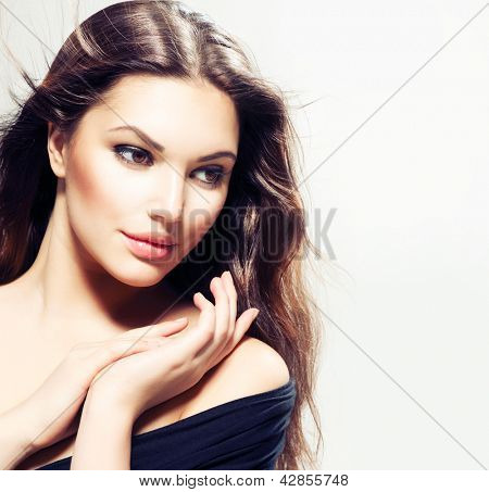 Beauty Woman portrait with long hair. Beautiful Brunette Girl. Natural Beauty