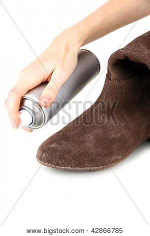 Process of cleaning suede shoes, isolated on white
