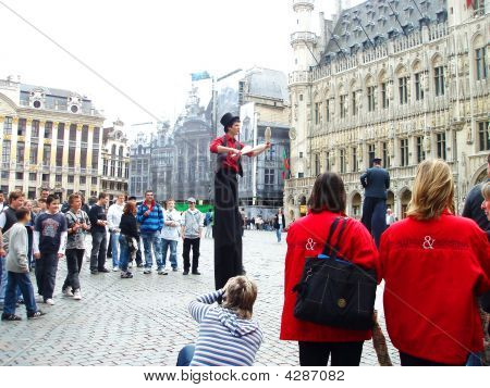Stilt Walking Man Dressed As Juggler