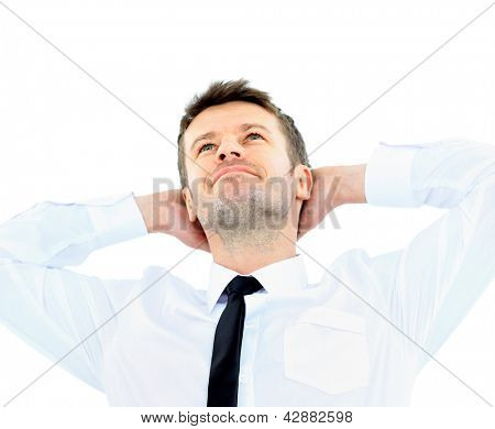 Portrait of handsome business man relaxing with hands behind head