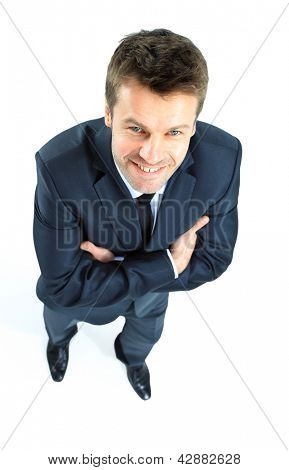 Portrait of a happy mature business man looking confident against white background