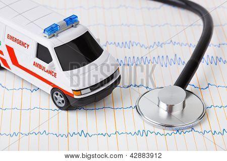 Stethoscope And Ambulance Car On Ecg