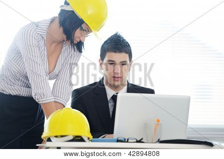 Engineers having discussion about new business project using laptop