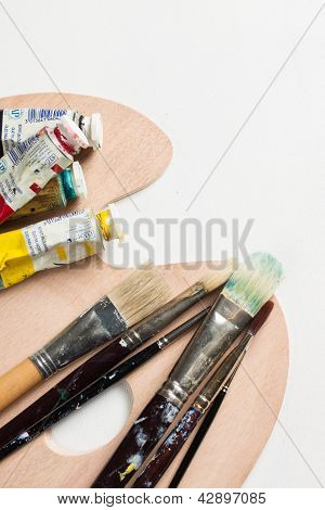 Paint Brushes And Paints On A Pallette