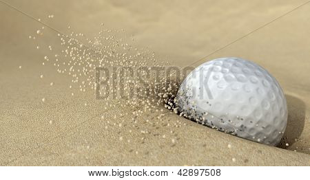 Golf Ball In Action Hitting Bunker Sand