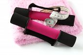 Black-pink Dumbbell With Handle And Measuring Tape On Towel