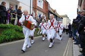 HASTINGS, ENGLAND - MAY 7: Morris dancers perform during a parade at the Jack In The Green festival