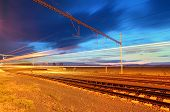stock photo of passenger train  - passenger train station with blurred train  - JPG