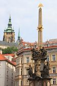stock photo of illuminati  - Urban scenic of Prague with baroque column of Holy Trinity in front of St - JPG