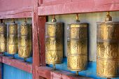 image of bator  - Row of buddhist prayer wheels in Gandan Monastery Mongolia - JPG