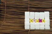 image of diabetes symptoms  - Sugar lumps and word sugar - JPG