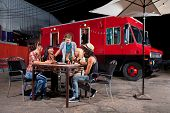 image of patron  - Laughing friends at food truck eating pizza slices - JPG
