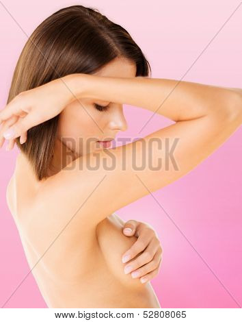 health, medicine, beauty concept - woman checking breast for signs of cancer