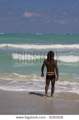 Man Going In The Sea In Cuba
