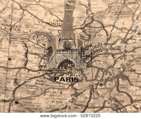 Retro Eiffel Tower on a map of Paris, short focus.