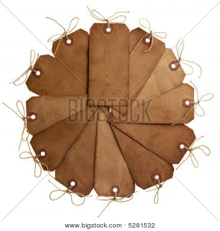 Twelve Different Grunge Paper Tags With Bow String In Clock Shape