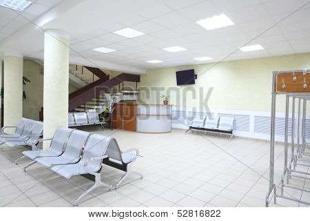 Spacious room with a seating area, the reception and staircase
