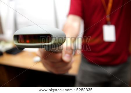 Man With Bar Code Reader In Action