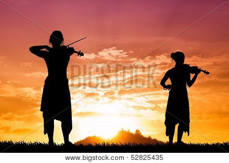 Violinists At Sunset