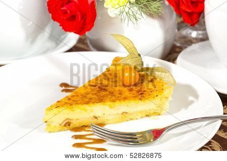 piece of cream cake on a table
