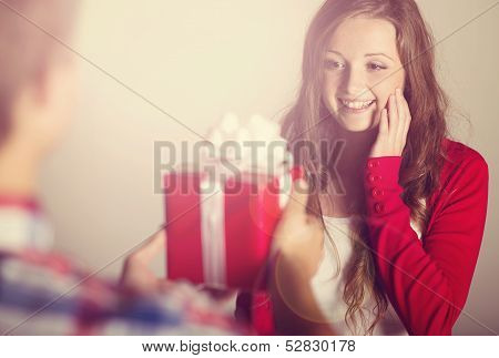 Man handing woman gift